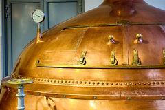 Distillery tanks brewery. Traditional copper distillery tanks in a beer brewery stock image