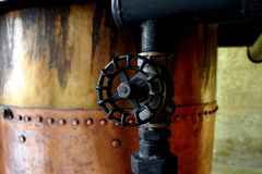 Distilling alcohol. Close up of tools for distilling alcohol royalty free stock images