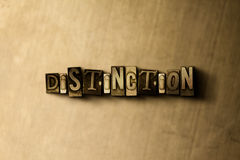 DISTINCTION - close-up of grungy vintage typeset word on metal backdrop Stock Images