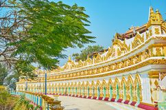 Distinctive colonnade of U Min Thonze Temple, Sagaing. Distinctive colonnade of U Min Thonze Temple with rich gilt patterns and numerous images of Lord Buddha royalty free stock photos