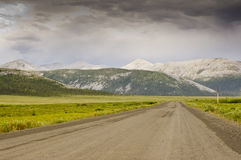 Distinctive mountains along the Dempster Highway. Distinctive bare eroded mountains under storm clouds as seen along the gravel Dempster Highway in the Yukon Royalty Free Stock Images