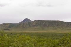 Distinctive mountains along the Dempster Highway. Distinctive mountain formations seen along the Dempster Highway in the Yukon, Canada Royalty Free Stock Image