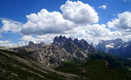 Distinctive mountains in the dolomites and dramatic clouds in the sky Stock Images
