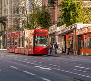 Distinctive red tram that runs through the city. Innsbruck, Austria, Europa.  Royalty Free Stock Photos