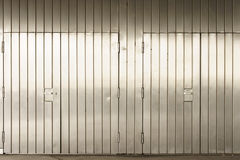 Distinctive stainless steel gates. A striking stainless steel wall with sealed entrance gates Royalty Free Stock Photo