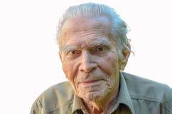 Distinguished elderly man looking at rhe camera royalty free stock photos