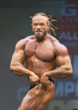 Distintively Coiffed Aussie Bodybuilder Grabs Attention at Toronto Contest. Bodybuilder Gary Wright of Australia makes an intimidating impression at the stock photography