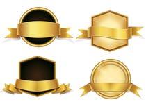 Distintivi dei nastri dell'oro, insegne messe Fotografia Stock