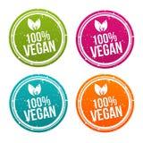 Distintivi 100% del vegano messi nei colori differenti illustrazione vettoriale