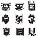 Distintivi di assicurazione della stretta di mano Fotografia Stock