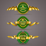 Distintivi dorati Fotografia Stock