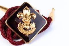 Distintivo d'annata dei boy scout su fondo bianco Fotografie Stock