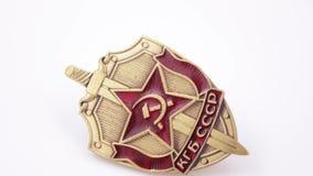Distintivo del ferro KGB su bianco stock footage