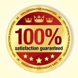 Distintivo garantito soddisfazione di rosso 100% con dorato Fotografia Stock Libera da Diritti