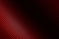 Distorted black carbon fiber smooth on surface. Stock Images
