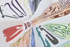 Distorted economy. English banknotes distorted to signify UK financial problems Royalty Free Stock Images