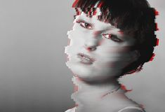 Distorted glitch style portrait girl. Modern trendy background design. Man on gray background with pixel distortion Stock Photos