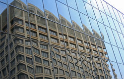 Distorted reflection. Of an office building in glass panels of another building Royalty Free Stock Photography