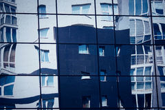 Distorted reflection of the city architecture Royalty Free Stock Image