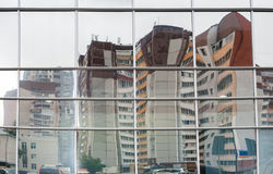 Distorted reflection of multi-storied residential buildings in m Royalty Free Stock Images