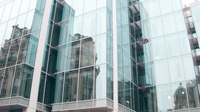 Distorted reflection of old building in modern glass facade of office center in Paris. Old and new, opposites concepts stock video footage