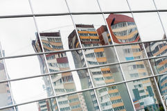 Distorted reflection of residential buildings in mirror surface Royalty Free Stock Photography