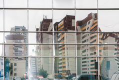 Distorted reflection of several residential buildings in mirror Stock Photo