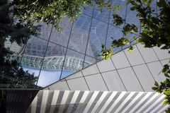 Distorted reflections of building. Triangles green blue gray silver stock images