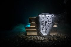 Free Distorted Soft Melting Clock On A Wooden Bench, The Persistence Of Memory Of Salvador Dali Stock Image - 143426681