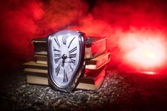 Free Distorted Soft Melting Clock On A Wooden Bench, The Persistence Of Memory Of Salvador Dali Stock Photo - 145467420