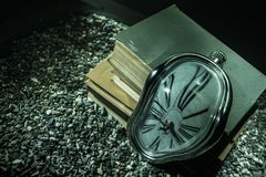 Free Distorted Soft Melting Clock On A Wooden Bench, The Persistence Of Memory Of Salvador Dali Stock Images - 145467434