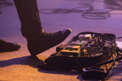 Distortion effect pedals under foot Stock Photos