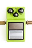 Distortion efx pedal. A distortion guitar effects pedal with input and output plugs isolated on a white background Stock Photo