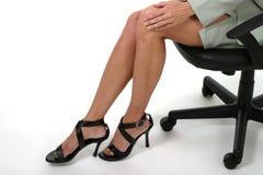 Distracción de las piernas en la oficina de asunto 3 Imágenes de archivo libres de regalías