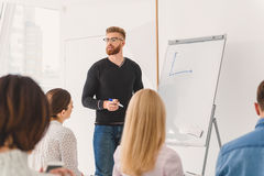 Distracted bearded man looking at audience Royalty Free Stock Images