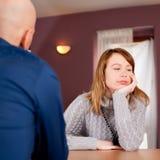 Distracted couple in cafe. Distracted couple in stilysh cafe Royalty Free Stock Image