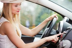 Woman changing radio station in her car. Distracted driver. Female hand changing radio station in her car stock images
