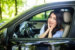 Distracted fright face of a woman driving car, wide open mouth side window view. Negative human face expression emotion reaction. Distracted fright face of a stock images