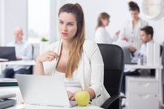 Distracted pregnant woman at work royalty free stock photo