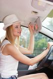 Distracted woman driving her car looking in mirror royalty free stock photos