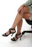 Distracting Legs in Business Office 1. Attractive and but distracting legs of executive business woman sitting in office chair royalty free stock images