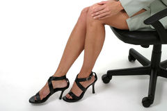Distracting Legs in Business Office 3. Attractive and sexy but distracting legs of executive business woman sitting in office chair. Landscape orientation. Shot Royalty Free Stock Images