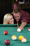 Distraction. Girl distracts a pool player stock photo