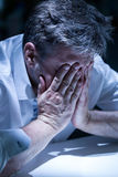 Distraught man in the office Stock Photo
