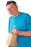 Distraught Mature Man with Booze. Distraught mature man with bottle of booze in paper bag, isolated on white background Stock Image