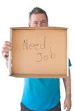 Distraught Mature Man Needs Job. Distraught mature man holding sign saying Needs Job, isolated on white background Royalty Free Stock Photography