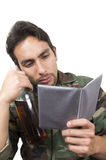 Distraught military soldier veteran holding a Stock Photo