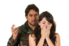 Distraught military soldier veteran ptsd fighting. With wife isolated on white Royalty Free Stock Photos