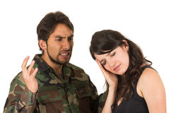 Distraught military soldier veteran ptsd fighting. With wife isolated on white Stock Photos