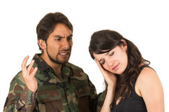 Distraught military soldier veteran ptsd fighting. With wife isolated on white Royalty Free Stock Photography